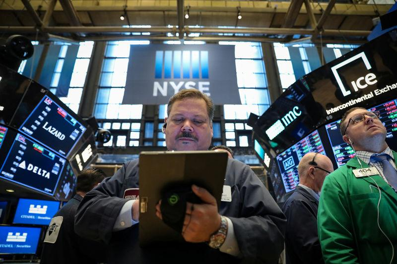 FILE PHOTO: Traders work on the floor at the New York Stock Exchange (NYSE) in New York, U.S., April 24, 2019. REUTERS/Brendan McDermid