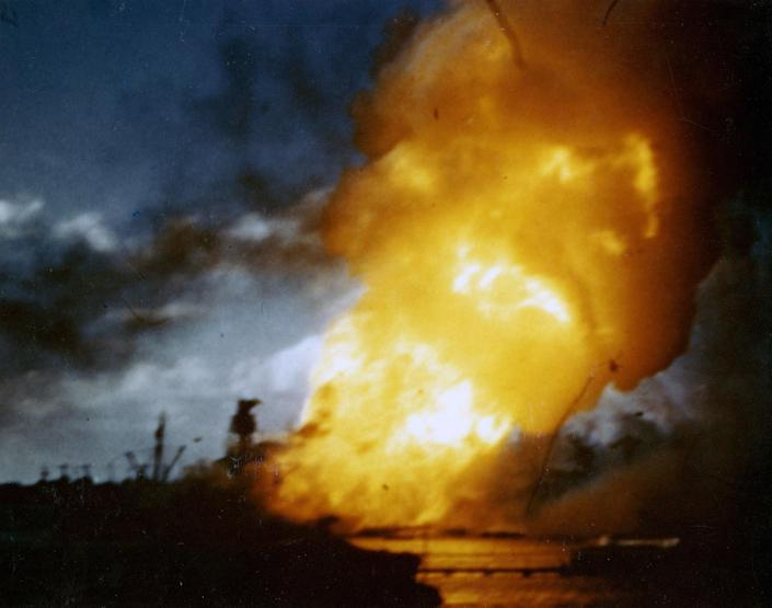 <p>The battleship USS Arizona burns, immediately following the explosion of its forward magazines, during the Japanese attack on Pearl Harbor on Dec. 7, 1941. The still image is from a color motion picture taken on board the hospital ship USS Solace. (Eric Haakenson/U.S. Navy/National Archives/Handout via Reuters) </p>