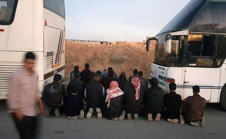 Rebels pray before they are evacuated from the town of Douma, eastern Ghouta, in Damascus