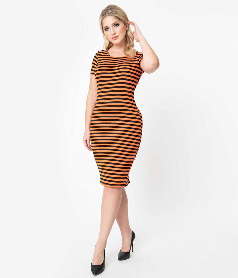 <p>Dare to be dashing in this <span>Unique Vintage 1960s Black and Orange Stripe Presley Wiggle Dress</span> ($58).</p>