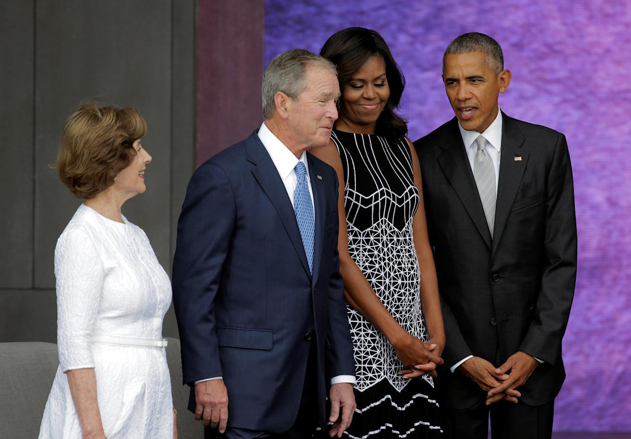 U.S. President Barack Obama, U.S. First Lady Michelle Obama, former U.S. President George W. Bush and former First Lady Laura Bush attend the dedication of the Smithsonian's National Museum of African American History and Culture in Washington, U.S., September 24, 2016. REUTERS/Joshua Roberts