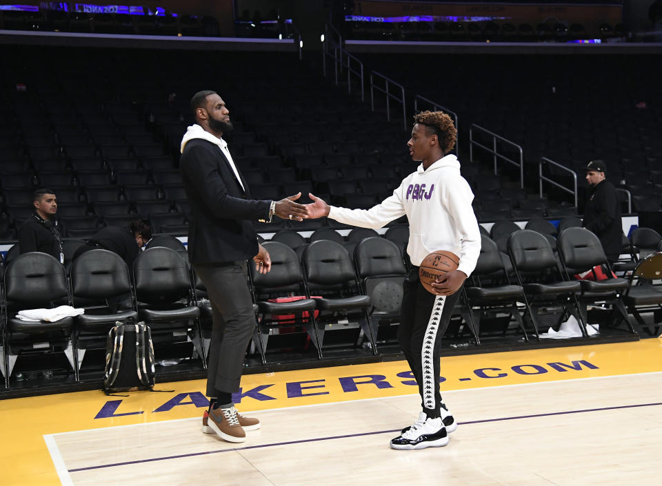 LeBron James his son LeBron James Jr., on the court after the Los Angeles Clippers and Los Angeles Lakers basketball game at Staples Center.