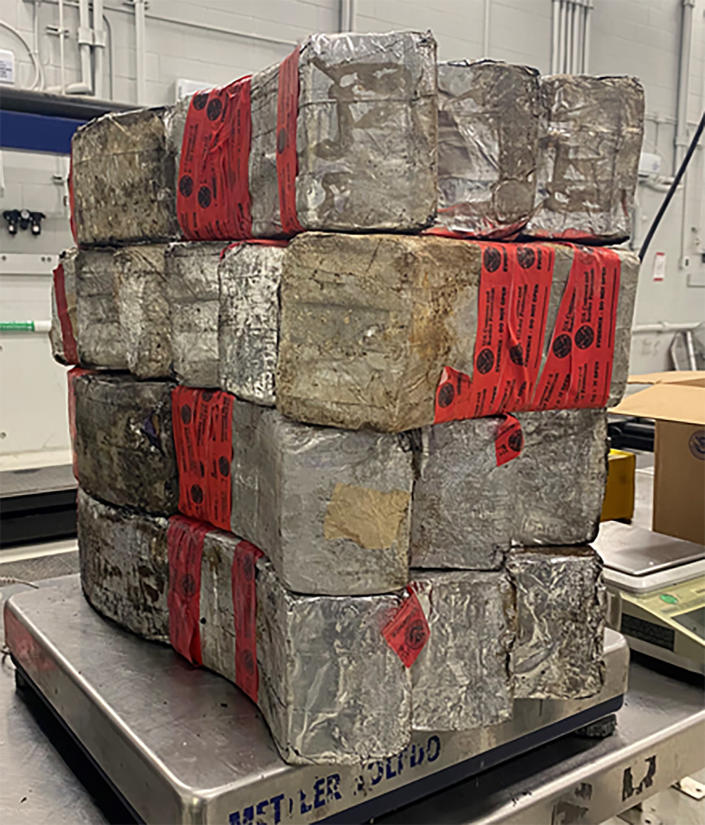 This undated photo provided by the U.S. Customs and Border Protection shows seized drug bundles containing 132 pounds of methamphetamine on display from Feb. 25, 2021, at the Laredo port of entry. The drugs were concealed in a vehicle driven by 23-year-old U.S. citizen traveling from Mexico. Since the start of the coronavirus pandemic, an increasing number of U.S. citizens have been apprehended while they have tried to smuggle illegal drugs at the Southwest border. (U.S. Customs and Border Protection via AP)