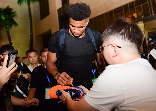 The NBA is discouraging players from physical interactions with fans. (Photo by Guan Yunan/VCG via Getty Images)