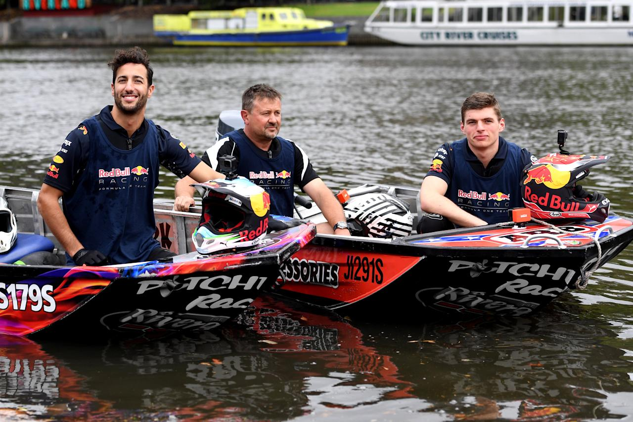Australian Formula One driver Daniel Ricciardo (L) and his Red Bull teammate Max Verstappen from The Netherlands race speedboats on the Yarra River during a promotional event in Melbourne, Australia, March 22, 2017. AAP/Tracey Nearmy/via REUTERS    ATTENTION EDITORS - THIS IMAGE WAS PROVIDED BY A THIRD PARTY. EDITORIAL USE ONLY. NO RESALES. NO ARCHIVE. AUSTRALIA OUT. NEW ZEALAND OUT.