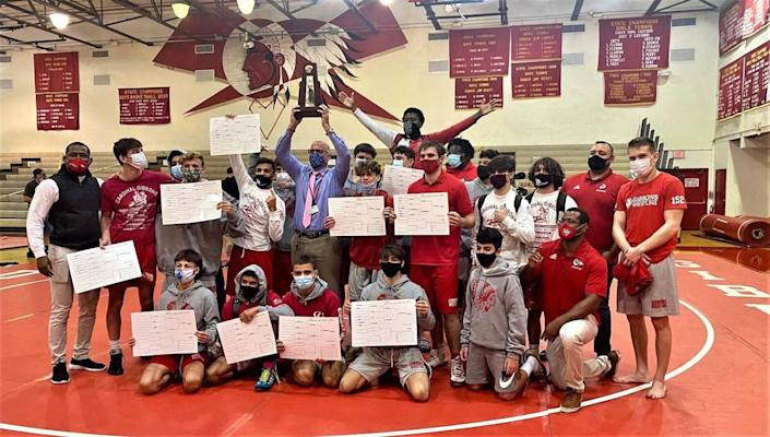 Cardinal Gibbons High School wrestling won a 1A district title.