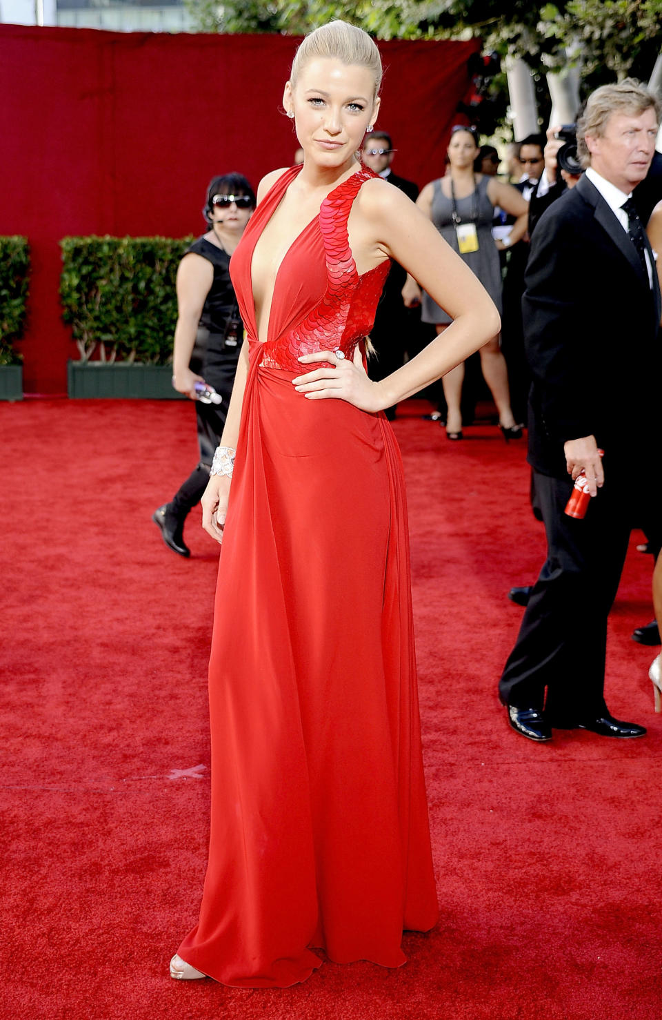 <p>Blake Lively turned heads at the 2009 Emmy Awards in a red-hot Versace gown that remains one of her best red carpet looks of all time. (Image via Getty Images)</p>