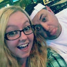 """This 2013 photo provided by Robert Olds shows Rikki Olds, left, taking a selfie with her uncle Robert. Rikki Olds, 25, an employee of King Soopers, was slain Monday, March 22, 2021, in the supermarket shooting that killed multiple people in Boulder, Colo. Her grandmother choked up on the phone as she described the young woman she played a large role in raising. """"She was just a very kind and loving, bubbly person who lit up the room when she walked in,"""" said Jeanette Olds, 71, of Lafayette, Colo.(Courtesy of Robert Olds via AP)"""