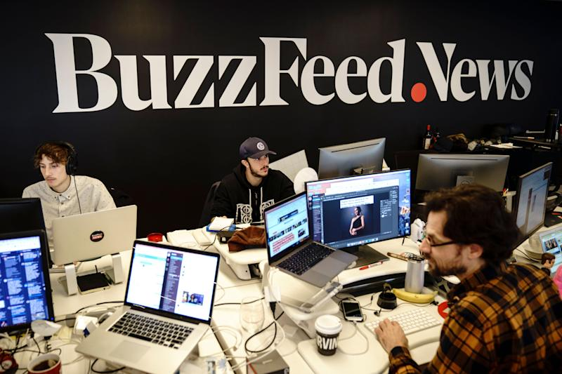 Members of the BuzzFeed News team work at their desks at BuzzFeed headquarters in New York. Employees at the internet media and news company have been demanding that management recognize their union. (Photo: Drew Angerer via Getty Images)