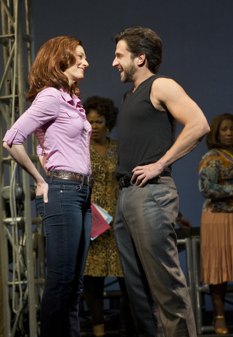 """In this theater image released by Boneau/Bryan-Brown, Jessica Phillips, left, and Raul Esparza are shown during a performance of """"Leap of Faith,"""" at the St. James Theatre in New York. (AP Photo/Boneau/Bryan-Brown, Joan Marcus)"""