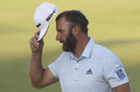 United States' Dustin Johnson reacts to the crowd after putting on the 18th green during the second round of the British Open Golf Championship at Royal St George's golf course Sandwich, England, Friday, July 16, 2021. (AP Photo/Ian Walton)