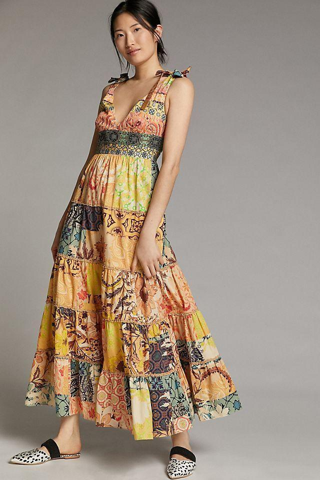 """<p><strong>Geisha Designs</strong></p><p>anthropologie.com</p><p><strong>$228.00</strong></p><p><a href=""""https://go.redirectingat.com?id=74968X1596630&url=https%3A%2F%2Fwww.anthropologie.com%2Fshop%2Frosalinda-patchwork-maxi-dress&sref=https%3A%2F%2Fwww.womenshealthmag.com%2Flife%2Fg36173394%2Fsummer-wedding-guest-dresses%2F"""" rel=""""nofollow noopener"""" target=""""_blank"""" data-ylk=""""slk:Shop Now"""" class=""""link rapid-noclick-resp"""">Shop Now</a></p><p>The patchwork design on this maxi dress will make you stand out in a good way! The tie straps are the cutest addition to an already lovely dress. </p>"""