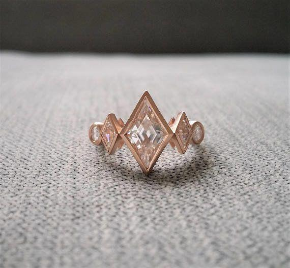 """<i><a href=""""https://www.etsy.com/listing/532593923/antique-moissanite-kite-shaped-geometric?ga_search_query=moissanite&ref=shop_items_search_29"""" target=""""_blank"""">Buy it fromPenelliBelle on Etsy</a>for $1,729.</i>"""