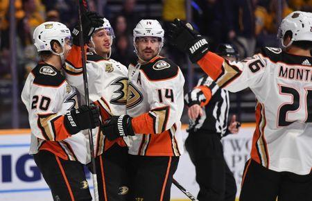 Nov 25, 2018; Nashville, TN, USA; Anaheim Ducks center Adam Henrique (14) celebrates with teammates after scoring a goal past Nashville Predators goaltender Pekka Rinne (35) during the second period at Bridgestone Arena. Mandatory Credit: Christopher Hanewinckel-USA TODAY Sports