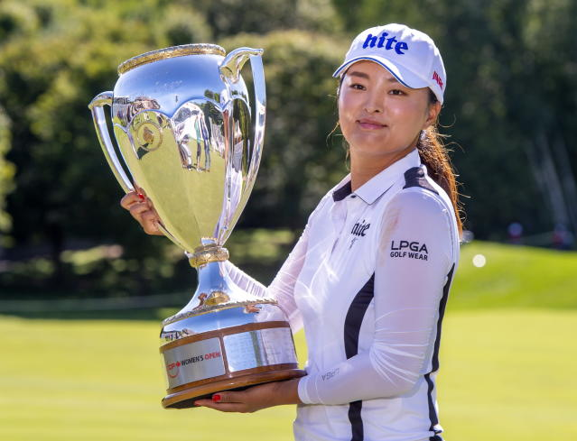 ,Jin Young Ko of South Korea poses with the trophy after winning the CP Women's Open in Aurora, Ontario, Sunday, Aug. 25, 2019. (Frank Gunn/The Canadian Press via AP)