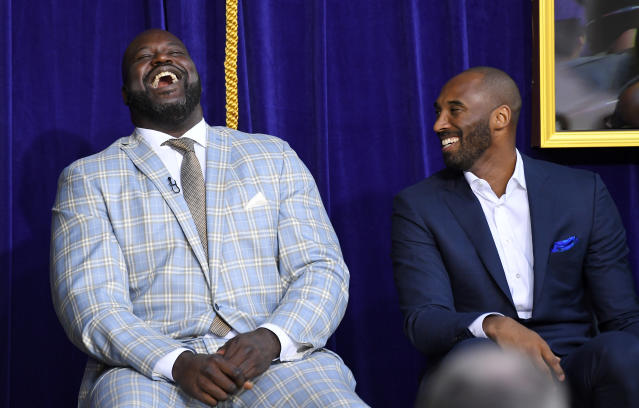 Shaquille O'Neal and Kobe Bryant share a laugh during the unveiling of Shaq's statue outside Staples Center. (AP)