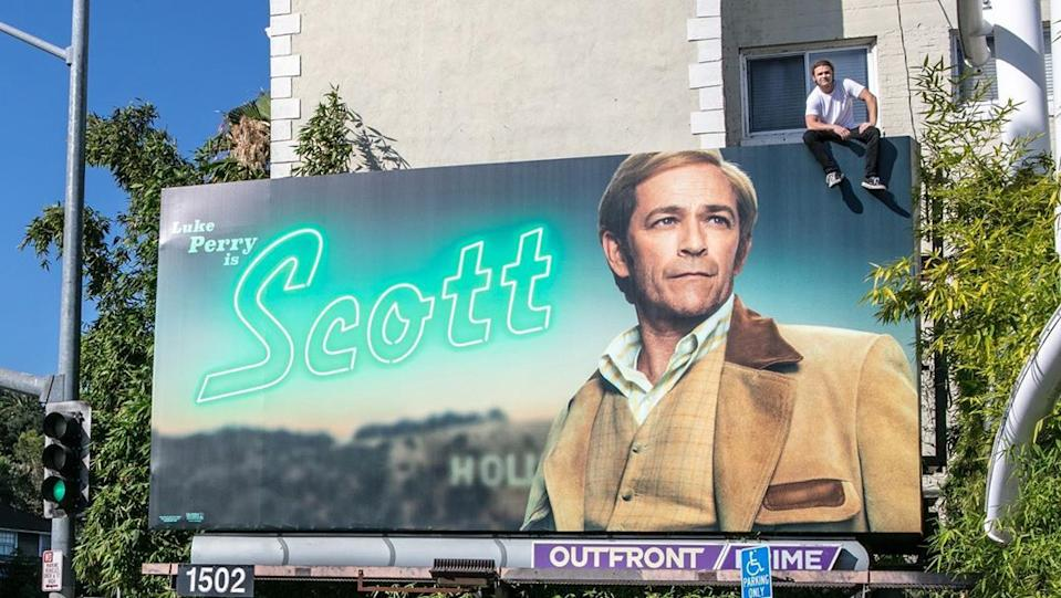 """Luke Perry's son, Jack, climbed atop an L.A. billboard featuring his late dad in character as Scott Lancer in Quentin Tarantino's new film """"Once Upon a Time in Hollywood."""" Jack, a wrestler, wrote, """"He deserved this, and I'm very proud of it."""" (Photo: boy_myth_legend via Instagram)"""
