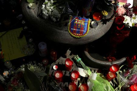 An impromptu memorial is seen a day after a van crashed into pedestrians at Las Ramblas in Barcelona
