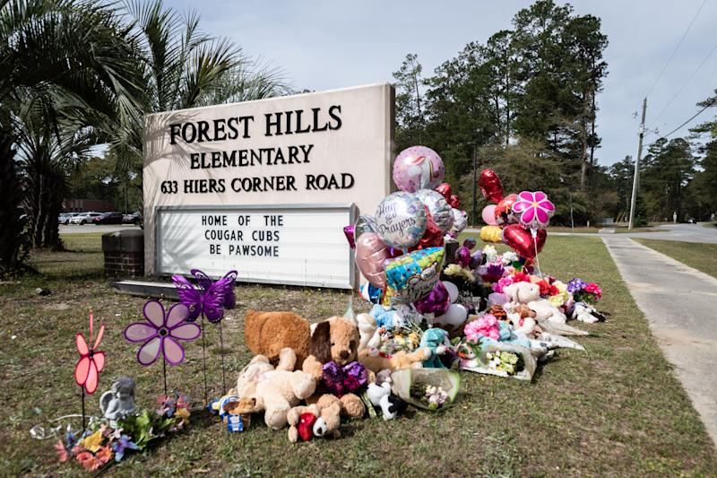 A memorial at the sign of Forest Hills Elementary School in Walterboro, S.C where Raniya Wright, the 5th-grade student who died Wednesday, Mar. 27 after a fight Monday, Mar. 25, attended school.