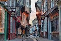 """<p>Picture-perfect from practically every angle, York is what you'd envisage when you think of a postcard English city. Surrounded by medieval walls, but with modern touches from shops and restaurants, York is the perfect mixture of history and contemporary sights - plus the Yorkshire Dales and North York Moors are nearby. No wonder the <a href=""""https://www.thetimes.co.uk/"""" rel=""""nofollow noopener"""" target=""""_blank"""" data-ylk=""""slk:Sunday Times"""" class=""""link rapid-noclick-resp"""">Sunday Times</a> voted it as the best place to live in the UK. </p><p><a class=""""link rapid-noclick-resp"""" href=""""https://go.redirectingat.com?id=127X1599956&url=https%3A%2F%2Fwww.airbnb.co.uk%2Fs%2FYork--United-Kingdom&sref=https%3A%2F%2Fwww.cosmopolitan.com%2Fuk%2Fentertainment%2Ftravel%2Fg30397906%2Fbest-places-to-visit-uk%2F"""" rel=""""nofollow noopener"""" target=""""_blank"""" data-ylk=""""slk:BOOK NOW"""">BOOK NOW</a></p>"""