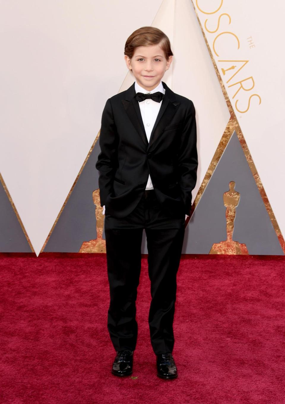 <p>Jacob Tremblay, who stole the show in Oscar-nominated film <i>Room,</i> was a red carpet winner in an Armani tuxedo and <i>Star Wars</i>-themed cuff links. <i><i>(Photo: Getty Images)</i></i></p>