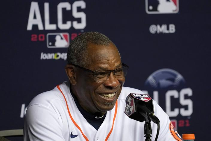Houston Astros manager Dusty Baker smiles as he responds to questions during a baseball news conference in Houston, Thursday, Oct. 14, 2021. The Astros host the Boston Red Sox in Game 1 of the American League Championship Series on Friday. (AP Photo/Tony Gutierrez)