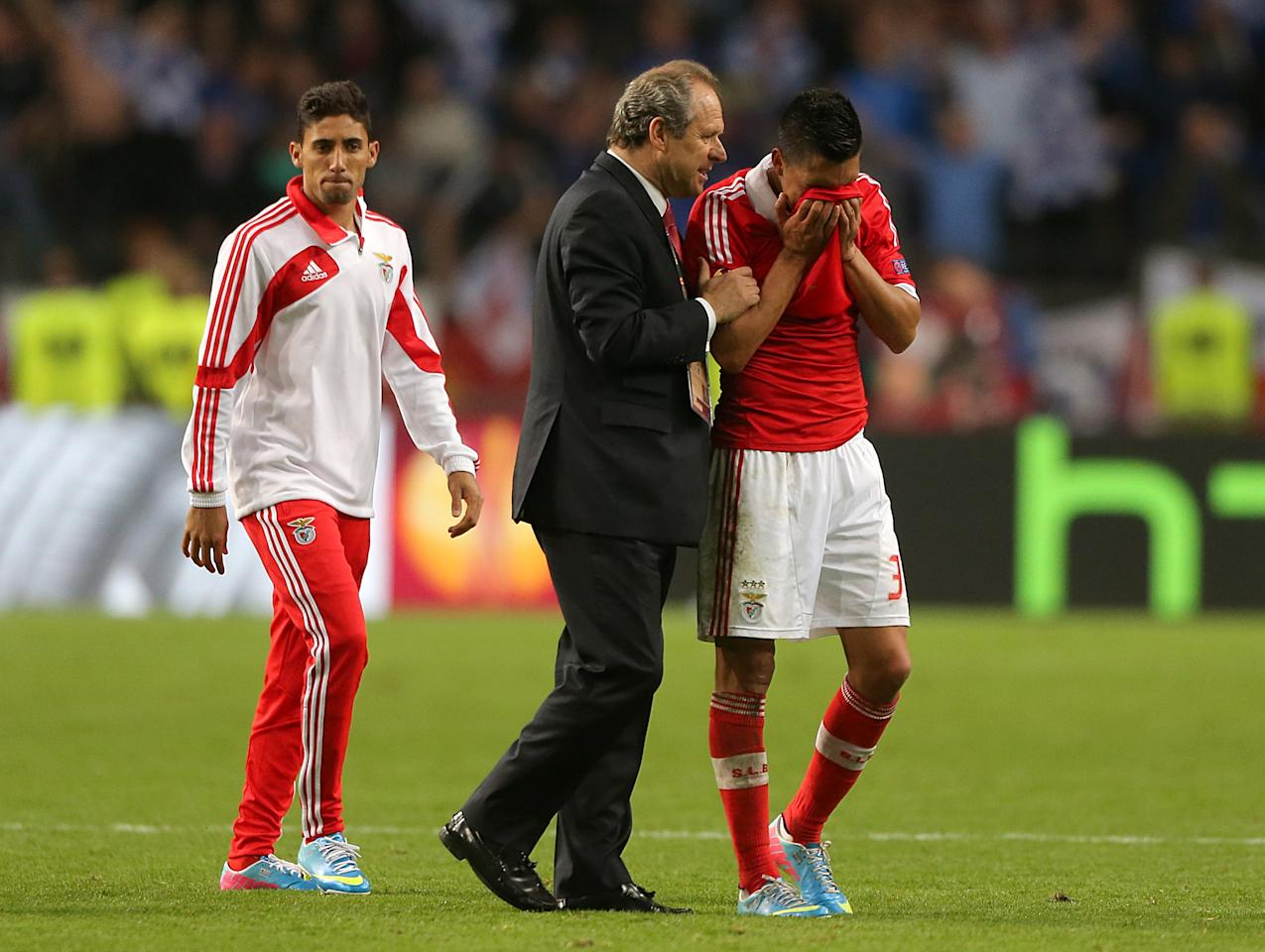 Benfica's Enzo Perez (right) looks dejected after the game