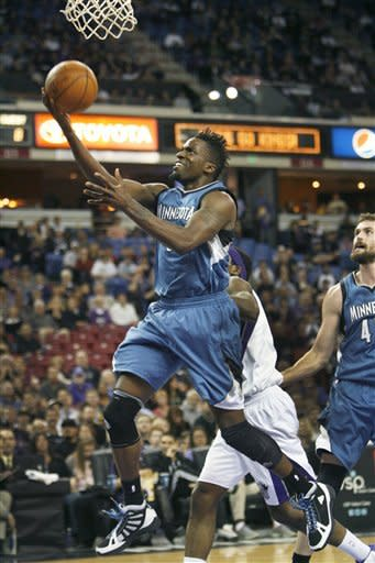 Minnesota Timberwolves guard Martell Webster, left, drives to the basket past Sacramento Kings defender John Salmons during the first half of an NBA basketball game in Sacramento, Calif., Sunday, March 18, 2012. (AP Photo/Steve Yeater)