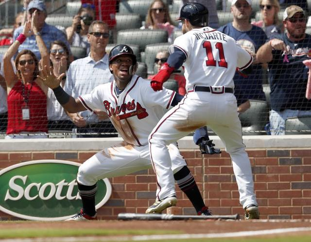 Atlanta Braves rookie Ronald Acuña Jr. celebrates with Ender Inciarte during a key moment in their division-clinching win against the Philadelphia Phillies. (AP)
