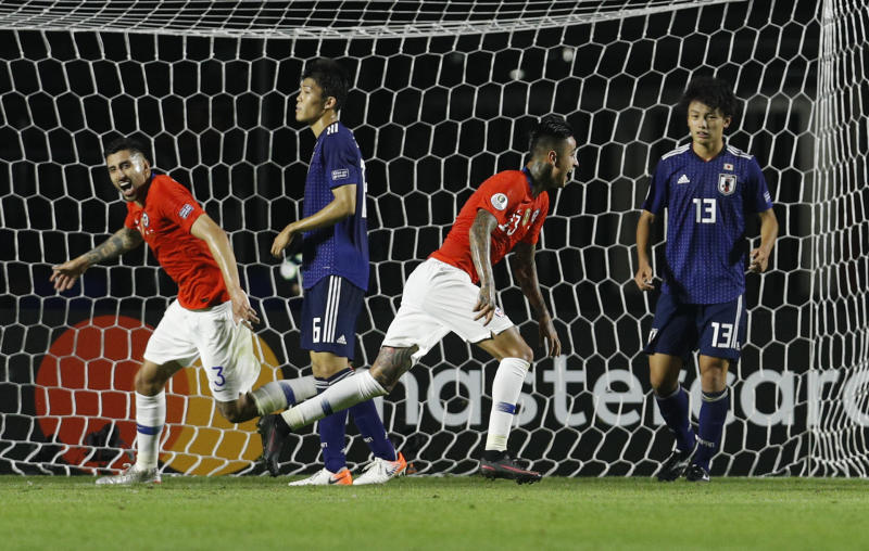 Chile's Erick Pulgar, second from right, celebrates scoring his side's opening goal during a Copa America Group C soccer match against Japan at Morumbi stadium in Sao Paulo, Brazil, Monday, June 17, 2019. (AP Photo/Victor R. Caivano)