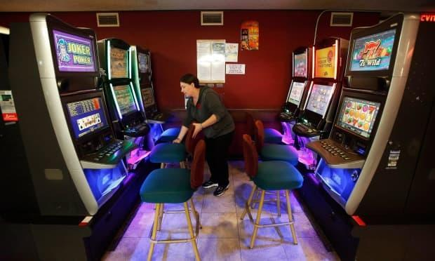 A server organizes the VLT area at a Royal Canadian Legion location in Winnipeg in 2018.