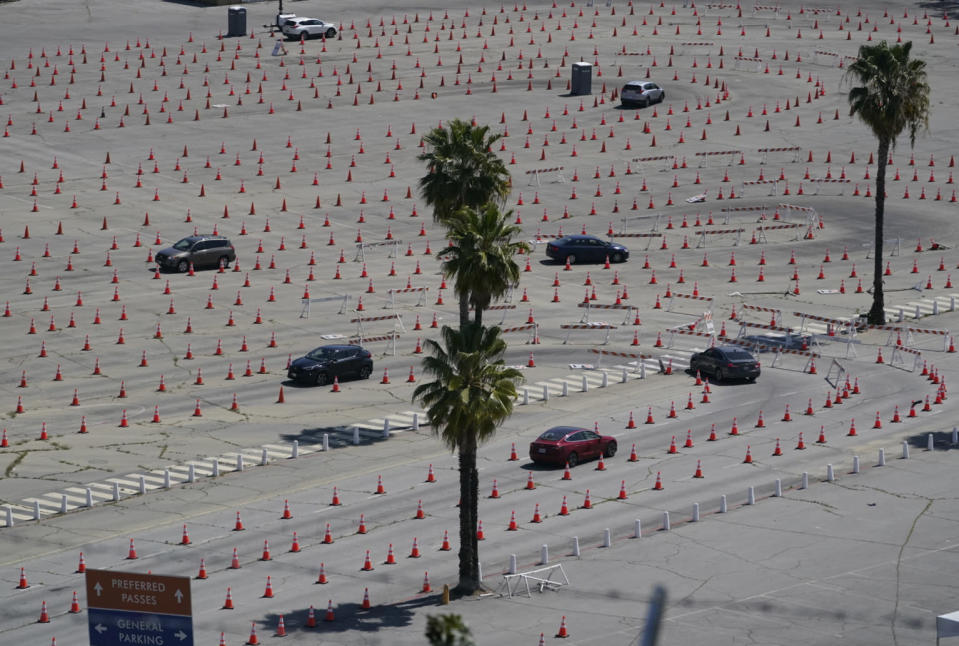 Vehicles drive around a maze of traffic cones, as they line up at the Dodgers Stadium vaccination site in Los Angeles Friday, April 2, 2021. California has administered nearly 19 million doses, and nearly 6.9 million people are fully vaccinated in a state with almost 40 million residents. But only people 50 and over are eligible statewide to get the vaccine now. Adults 16 and older won't be eligible until April 15. (AP Photo/Damian Dovarganes)