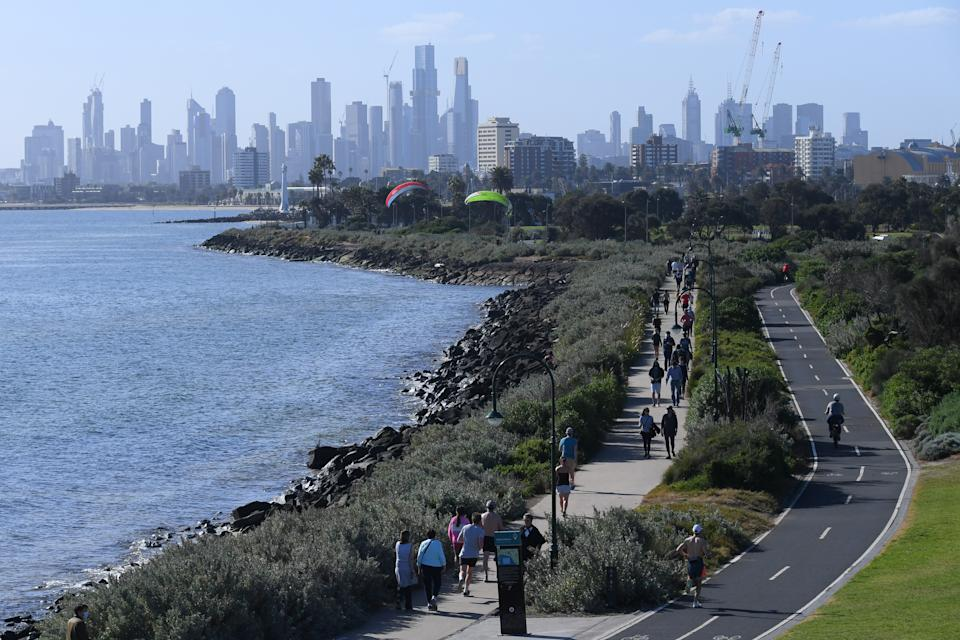 People are seen exercising and enjoying the sunshine in Melbourne during lockdown. Source: AAP