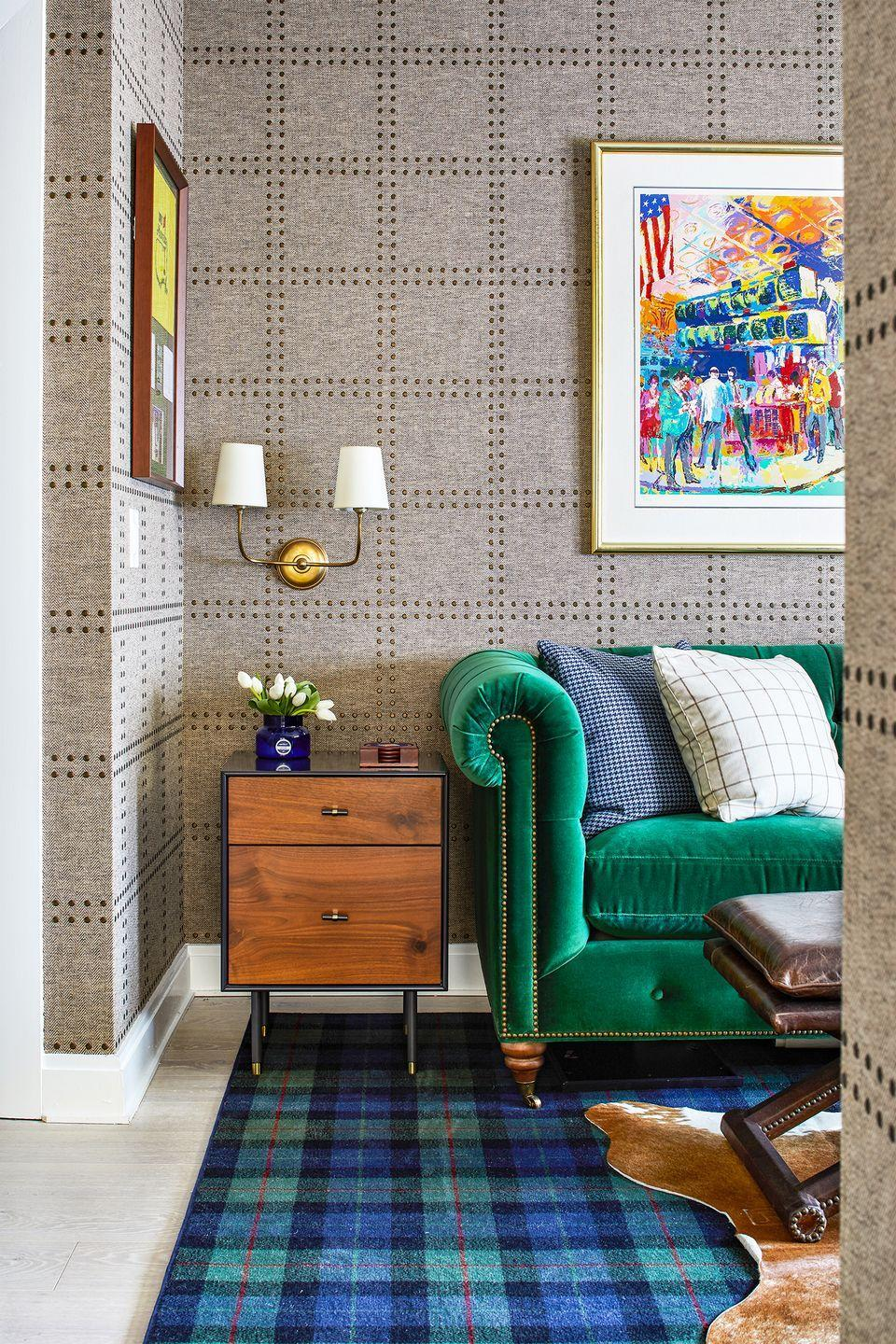 """<p>In sitting room designed by <a href=""""http://cameronruppertinteriors.com"""" rel=""""nofollow noopener"""" target=""""_blank"""" data-ylk=""""slk:Cameron Ruppert Interiors"""" class=""""link rapid-noclick-resp"""">Cameron Ruppert Interiors</a>, the pearlized ink dots on Phillip Jeffries' Rivets wallcovering resemble nailheads, a look reflected in the actual metal studs on the green velvet sofa. So when it doubt, opt for a printed wallpaper that creates the optical illusion of texture.</p>"""