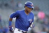 Iowa Cubs shortstop Addison Russell runs to first base during a Triple-A baseball game against the Nashville Sounds, Wednesday, April 24, 2019, in Des Moines, Iowa. Russell played in his first game of the season Wednesday for Iowa as he prepares to return to the Chicago Cubs following his domestic violence suspension. (AP Photo/Charlie Neibergall)