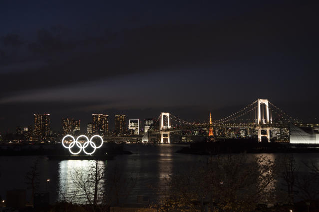 The Olympic rings float in the water near the Rainbow Bridge in the Odaiba section of Tokyo, Monday, March 23, 2020. The Tokyo Olympics are going to happen but almost surely in 2021 rather than in four months as planned. (AP Photo/Jae C. Hong)