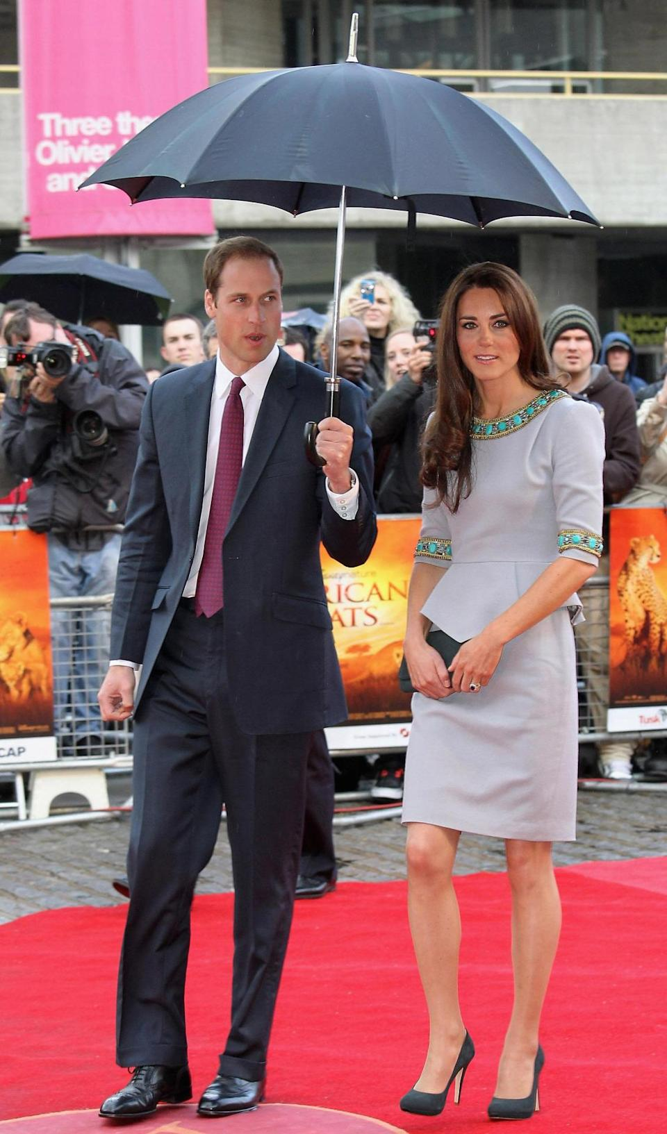 <p>The Duchess attended the UK premiere of <i>African Cats</i> in a beaded dress by Matthew Williamson. She paired the look with dark grey shoes and a matching clutch - both by Emmy London.</p><p><i>[Photo: PA]</i></p>