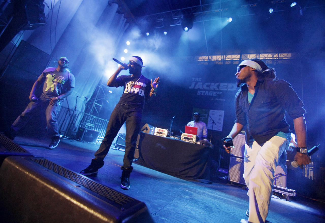 Hip hop group Turquoise Jeep performs on The JACKED Stage by Doritos in Austin, Texas, Saturday, March 17, 2012. The 56-foot-tall vending machine JACKED Stage was unveiled at SXSW to debut amped up new Doritos JACKED chips. (Darren Abate/AP Images for Doritos)