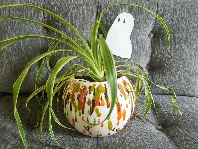"""<p>If you don't want to repot plants with a spooky vase for <a class=""""sugar-inline-link ga-track"""" title=""""Latest photos and news for Halloween"""" href=""""https://www.popsugar.com/Halloween"""" target=""""_blank"""" data-ga-category=""""Related"""" data-ga-label=""""https://www.popsugar.com/Halloween"""" data-ga-action=""""&lt;-related-&gt; Links"""">Halloween</a>, don't sweat it! The <a href=""""https://www.popsugar.com/buy/Ghost-Buddy-Plant-Stake-492099?p_name=Ghost%20Buddy%20Plant%20Stake&retailer=etsy.com&pid=492099&price=30&evar1=casa%3Aus&evar9=46619279&evar98=https%3A%2F%2Fwww.popsugar.com%2Fhome%2Fphoto-gallery%2F46619279%2Fimage%2F46636631%2FGhost-Buddy-Plant-Stake&list1=shopping%2Challoween%2Cetsy%2Challoween%20decor%2Chome%20shopping&prop13=api&pdata=1"""" rel=""""nofollow"""" data-shoppable-link=""""1"""" target=""""_blank"""" class=""""ga-track"""" data-ga-category=""""Related"""" data-ga-label=""""https://www.etsy.com/listing/648516241/ghost-buddy-plant-stake"""" data-ga-action=""""In-Line Links"""">Ghost Buddy Plant Stake</a> ($30) is an easy way to add a ghostly twist to your greens.</p>"""
