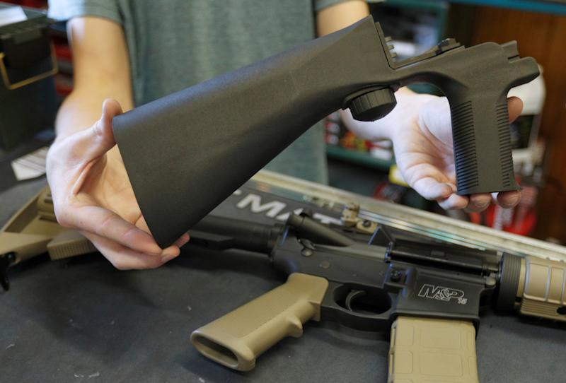 A bump stock, shown here in a Utah gun shop in October 2017, attaches to a semi-automatic rifle to increase its firing rate. (George Frey / Reuters)
