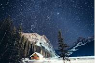 <p>Milky white snow below and the Milky Way above in Banff National Park, Canada.</p>