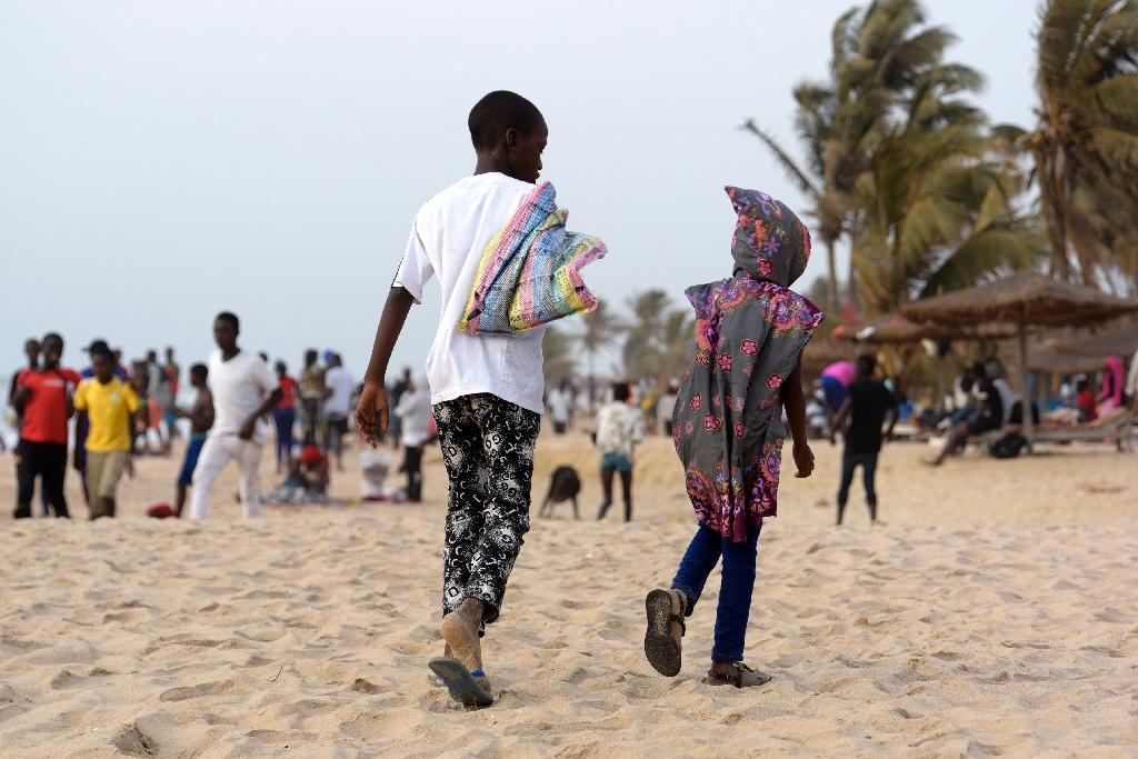 Child protection experts warn youngsters are being exploited in The Gambia's sex tourism trade, sometimes even with the knowledge of their families, who are often poor and need money. (AFP Photo/SEYLLOU)