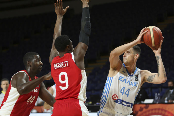 Canada's Andrew Nicholson, left, and teammate RJ Barrett defend against Greece's Mitoglou Konstantinos during the first half of a FIBA men's Olympic qualifying basketball game Tuesday, June 29, 2021 at Memorial Arena in Victoria, British Columbia. (Chad Hipolito/The Canadian Press via AP)