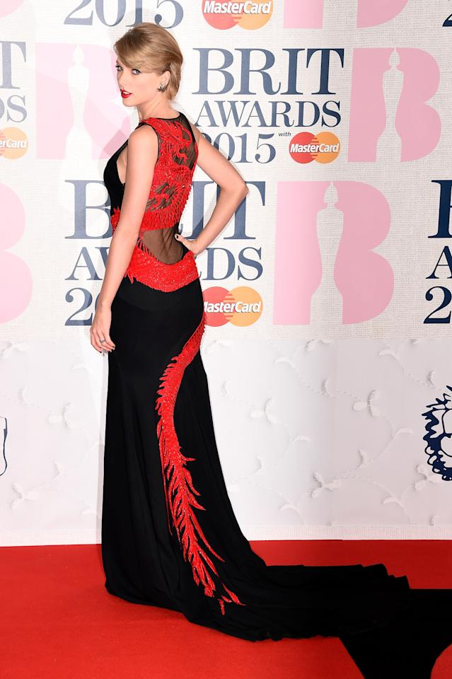 "Is there something in the British water that has Taylor Swift bringing sexy back (literally)? A the Elle Style Awards in the UK on Tuesday night the ""Style"" singer looked almost unrecognizable in a Julien MacDonald green dress and just the next night she sported a Roberto Cavalli Atelier gown that turned heads with a red embroidered dragon cascading down the back. Whatever has Swift changing up her typically cutesy style doesn't matter, she should stick with it."