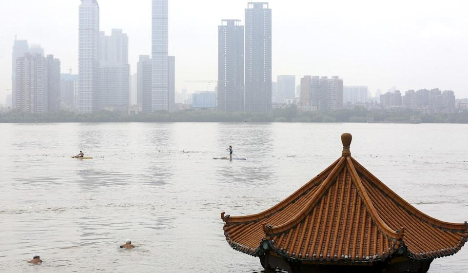 A submerged riverside pavilion in Wuhan, just months after the central Chinese city was devastated by the coronavirus pandemic. Photo: EPA-EFE