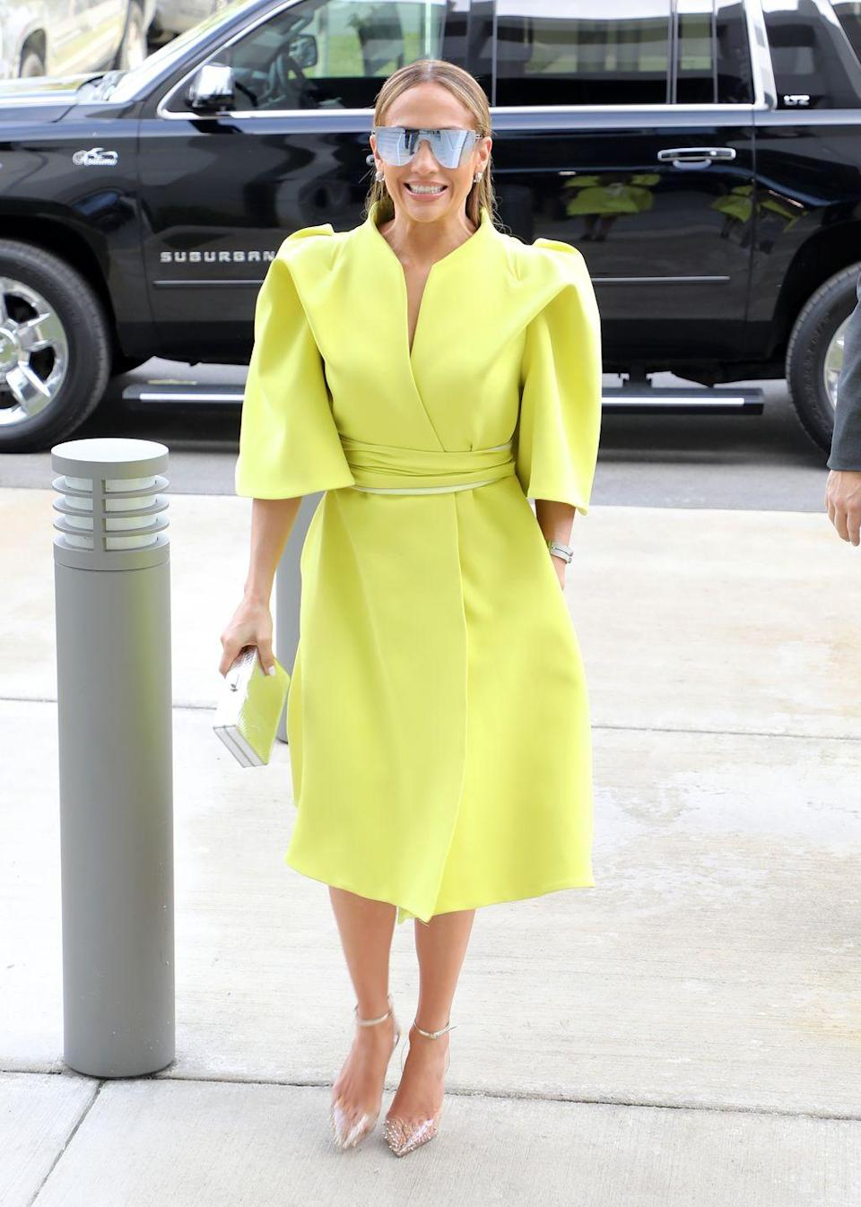 <p>In a lime green power dress and silver shades in Florida.</p>