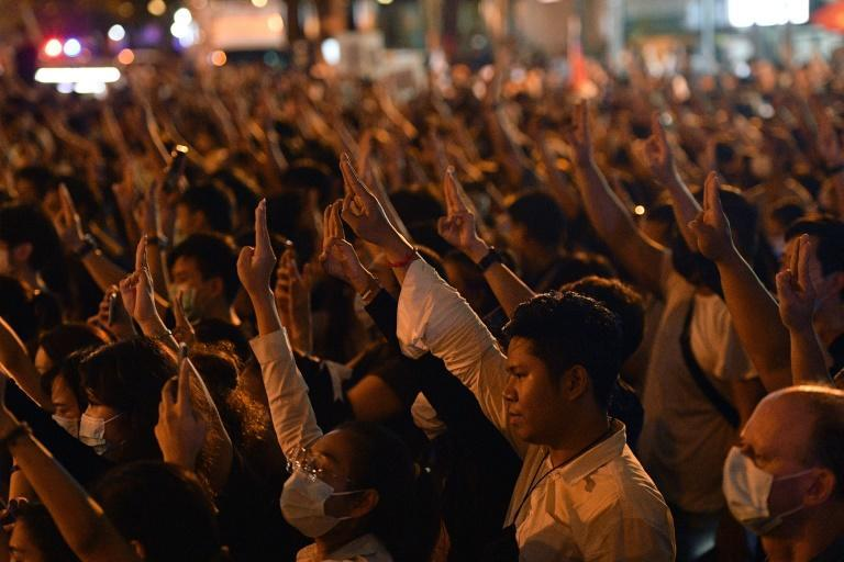 Pro-democracy protesters have adopted the hold the three-finger salute