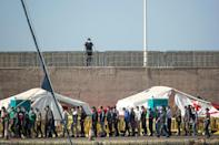 The Arguineguin port camp was put up to process arrivals and run virus tests but it has become saturated with more than 2,000 migrants sleeping there