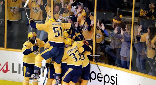 Kevin Fiala is buried, somewhere under there.(Getty)