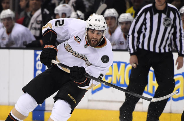 Anaheim Ducks left wing Patrick Maroon passes the puck during the first period of an NHL hockey game against the Los Angeles Kings, Saturday, April 12, 2014, in Los Angeles. (AP Photo/Mark J. Terrill)